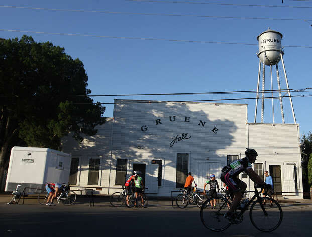 Cyclists gather to compete in the Two-Person Team Trials of the Tour de Gruene, Sunday, Nov. 4, 2012. The event was the last of the two-day time trials. Teams competed in a 26.6-mile course along River Road near Gruene and along FM 306. Photo: Jerry Lara, Express-News / © 2012 San Antonio Express-News