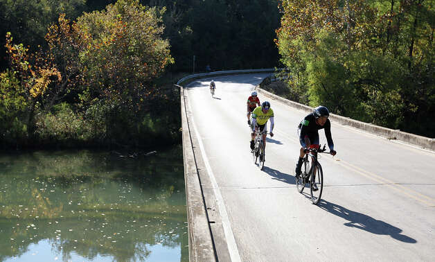 Cyclinst make it through the fourth river crossing while competing in the Two-Person Team Trials of the Tour de Gruene, Sunday, Nov. 4, 2012. The event was the last of the two-day time trials. Teams competed in a 26.6-mile course along River Road near Gruene and along FM 306. Photo: Jerry Lara, Express-News / © 2012 San Antonio Express-News