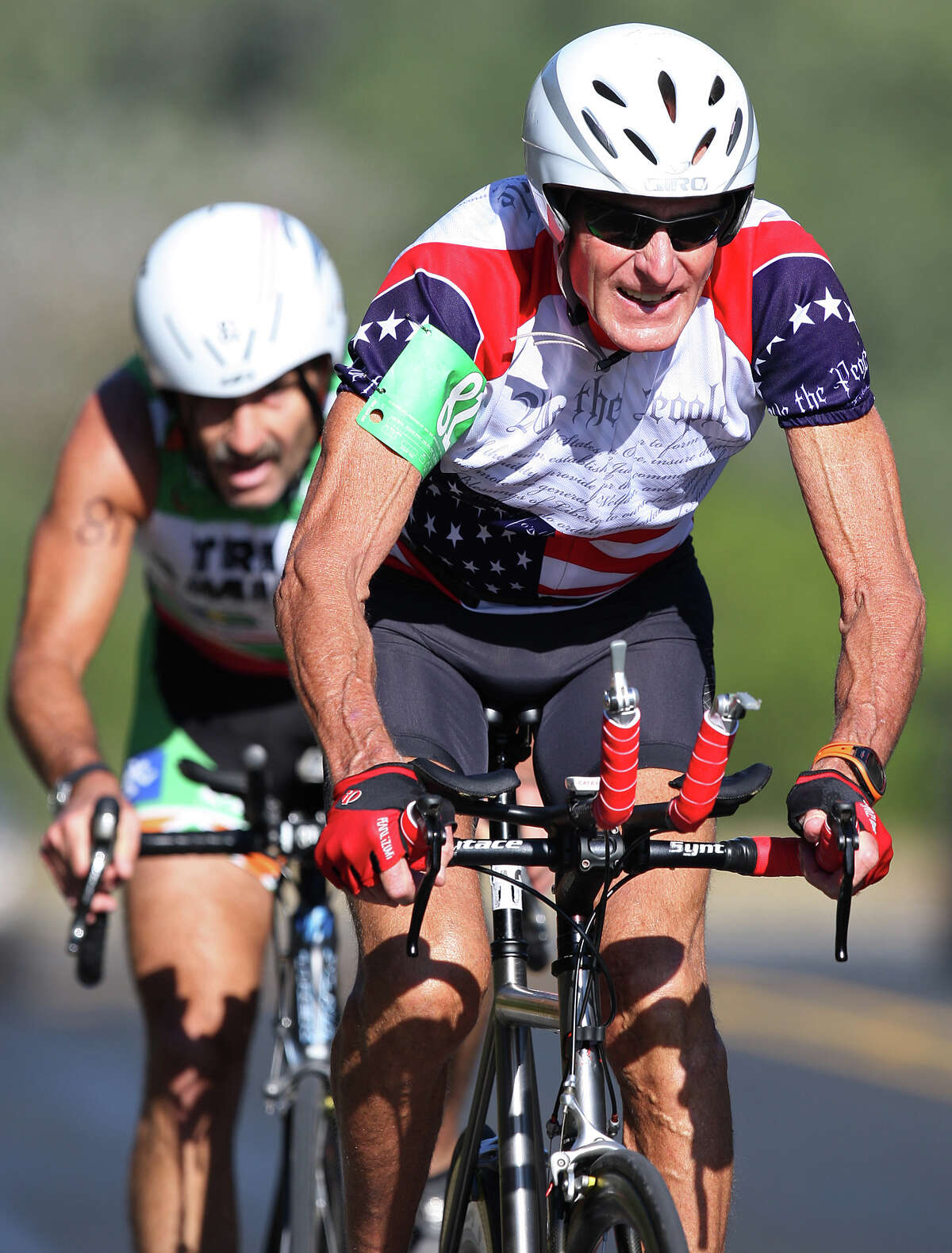 Dr. Darryl Cuda, left, and Orb Greenwald compete in the Aero Men 22+mph team trials of the Tour de Gruene, Sunday, Nov. 4, 2012. The Two-Person Team Time Trial was the last event of the two-day time trials. Teams competed in a 26.6-mile course along River Road near Gruene and along FM 306.