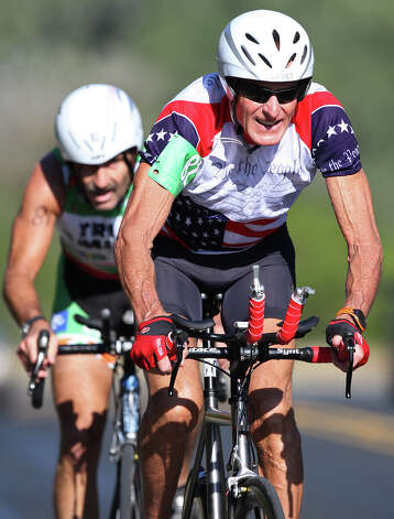 Dr. Darryl Cuda, left, and Orb Greenwald compete in the Aero Men 22+mph team trials of the Tour de Gruene, Sunday, Nov. 4, 2012. The Two-Person Team Time Trial was the last event of the two-day time trials. Teams competed in a 26.6-mile course along River Road near Gruene and along FM 306. Photo: Jerry Lara, Express-News / © 2012 San Antonio Express-News