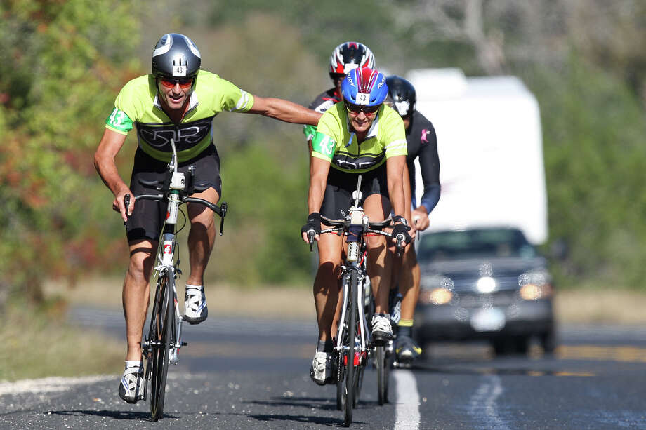 Tim Terwey, left, and Anne Stevenson, both from Austin, compete in the Co-Ed 22+mph team trials of the Tour de Gruene, Sunday, Nov. 4, 2012. The Two-Person Team Time Trial was the last event of the two-day time trials. Teams competed in a 26.6-mile course along River Road near Gruene and along FM 306. Photo: Jerry Lara, Express-News / © 2012 San Antonio Express-News