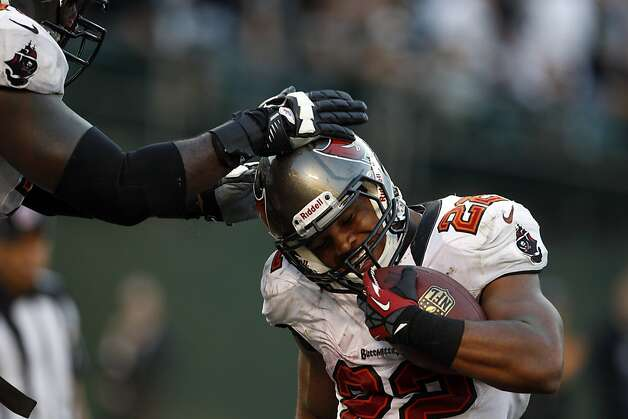 Buccaneers running back Doug Martin gets congratulated by a teammate after one of his four second-half touchdowns. Photo: Carlos Avila Gonzalez, The Chronicle