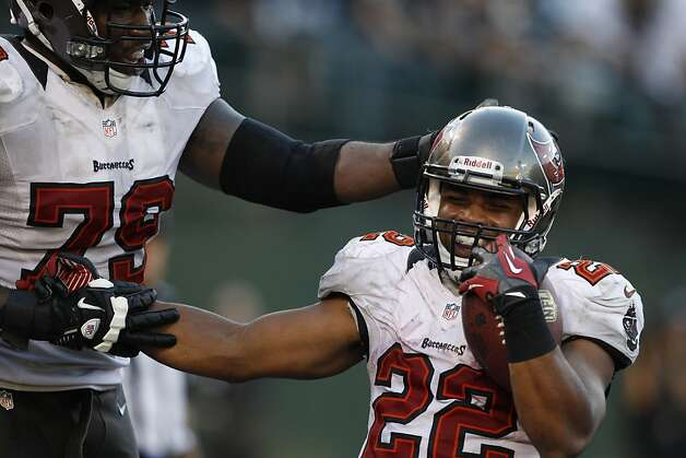 Doug Martin celebrates his fourth quarter touchdown. Martin ran for 251 yards and 4 touchdowns. The Oakland Raiders played the Tampa Bay Buccaneers at O.co Coliseum in Oakland, Calif., on Sunday, November 4, 2012, losing 42-32 to the Bucs. Photo: Carlos Avila Gonzalez, The Chronicle
