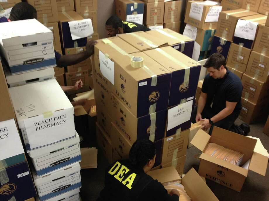 Agents have filled four rooms with evidence collected in an October raid of clinics and pharmacies in the Houston area allegedly involved in prescription fraud. Photo: DEA / DEA