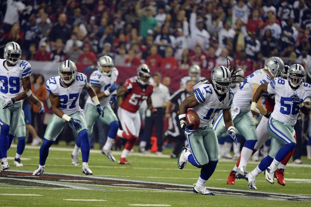 Dallas Cowboys wide receiver Dwayne Harris (17) returns a punt during the first half of an NFL football game against the Atlanta Falcons Sunday, Nov. 4, 2012, in Atlanta. (AP Photo/Rich Addicks)