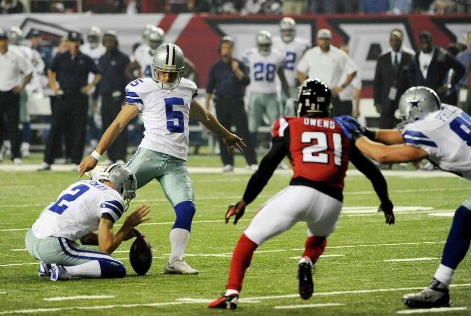 Dallas Cowboys kicker Dan Bailey (5) kicks a field goal  from the hold of  punter Brian Moorman during the first half of an NFL football game Sunday, Nov. 4, 2012, in Atlanta. (AP Photo/David Tulis) Photo: David Tulis, Express-News / FR170493 AP