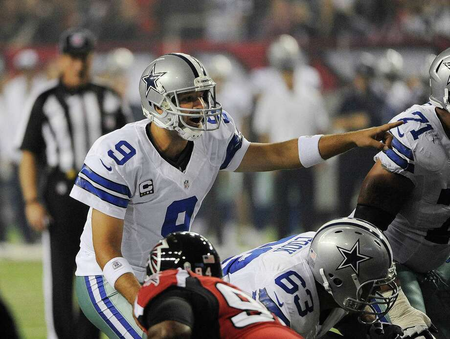 Dallas Cowboys quarterback Tony Romo (9) calls a play during the first half of an NFL football game against the Atlanta Falcons  Sunday, Nov. 4, 2012, in Atlanta. (AP Photo/David Tulis) Photo: David Tulis, Express-News / FR170493 AP