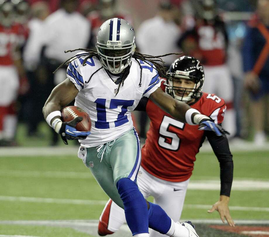 Dallas Cowboys wide receiver Dwayne Harris (17) breaks away from Atlanta Falcons punter Matt Bosher (5) as he returns a punt during the first half of an NFL football game Sunday, Nov. 4, 2012, in Atlanta. (AP Photo/Chuck Burton) Photo: Chuck Burton, Express-News / AP