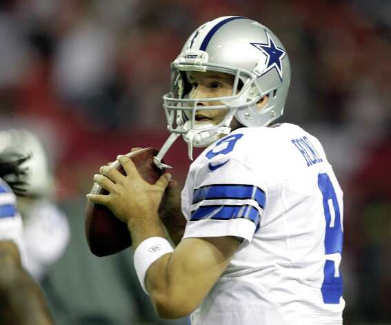 Dallas Cowboys quarterback Tony Romo (9) warms up before the first half of an NFL football game against the Atlanta Falcons Sunday, Nov. 4, 2012, in Atlanta. (AP Photo/Chuck Burton) Photo: Chuck Burton, Express-News / AP