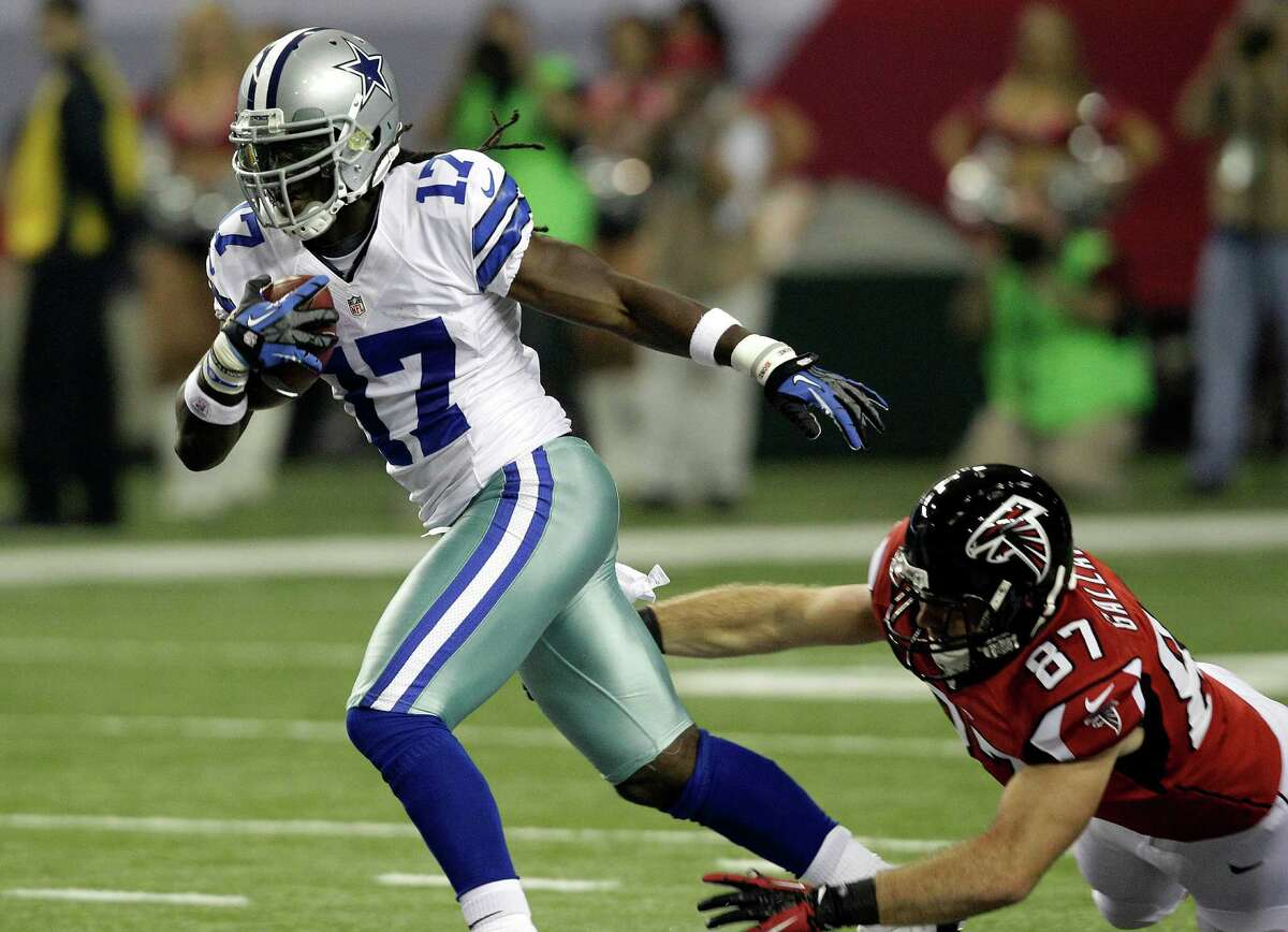 Dallas Cowboys wide receiver Dwayne Harris (17) breaks away from Atlanta Falcons tight end Tommy Gallarda (87) as he returns a punt during the first half of an NFL football game, Sunday, Nov. 4, 2012, in Atlanta. (AP Photo/Chuck Burton)
