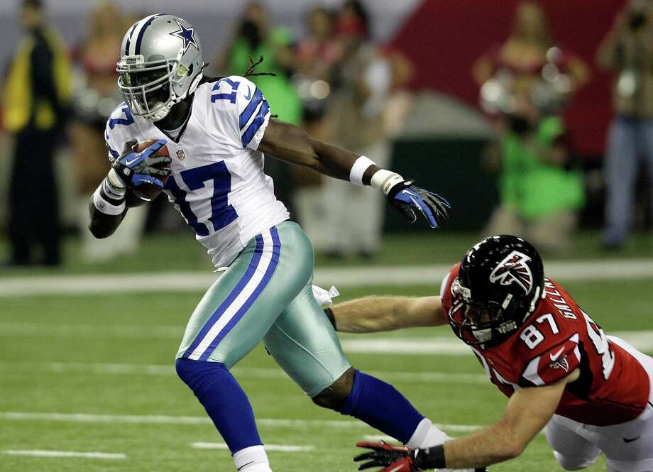 Dallas Cowboys wide receiver Dwayne Harris (17) breaks away from Atlanta Falcons tight end Tommy Gallarda (87) as he returns a punt during the first half of an NFL football game, Sunday, Nov. 4, 2012, in Atlanta. (AP Photo/Chuck Burton) Photo: Chuck Burton, Express-News / AP
