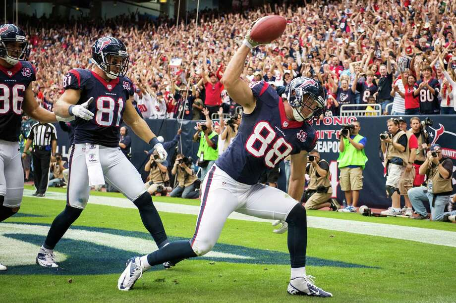 Texans tight end Garrett Graham (88) spikes the ball after scoring on a 5-yard touchdown pass during the fourth quarter against the Bills. Photo: Smiley N. Pool, Houston Chronicle / © 2012  Houston Chronicle