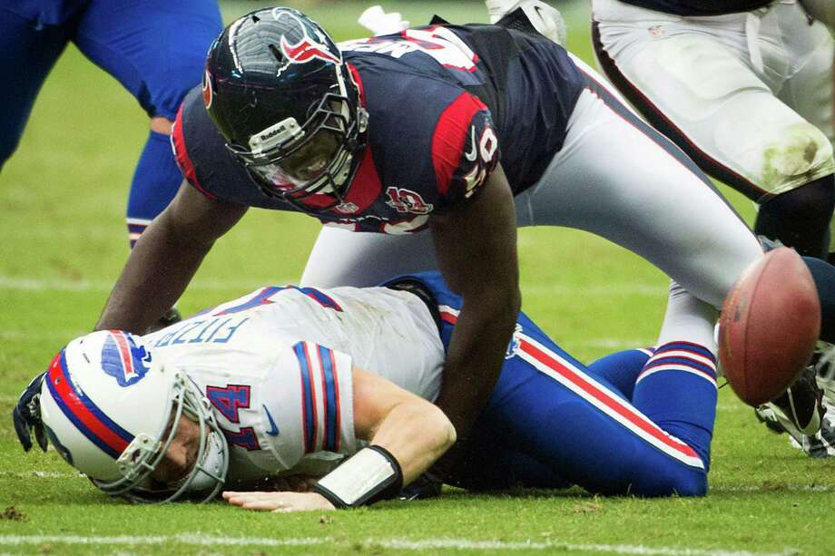 Bills quarterback Ryan Fitzpatrick (14) fumbles after being hit by Texans linebacker Whitney Mercilus (59) during the fourth quarter. Photo: Smiley N. Pool, Houston Chronicle / © 2012  Houston Chronicle
