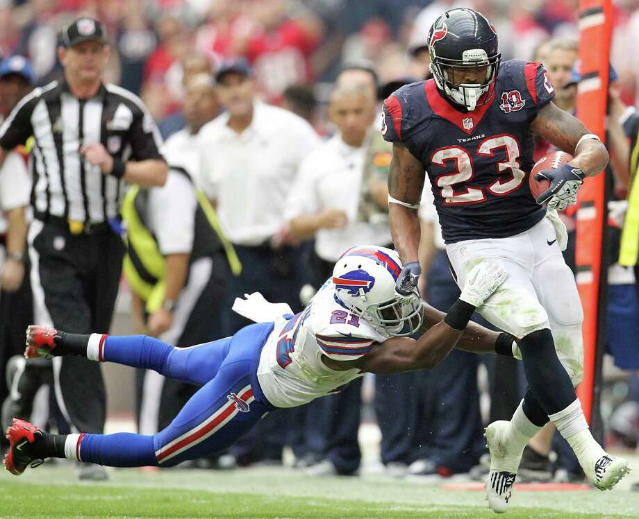 Texans running back Arian Foster (23) tries to slip past Bills cornerback Leodis McKelvin (21)  during the fourth quarter. Photo: Karen Warren, Houston Chronicle / © 2012  Houston Chronicle