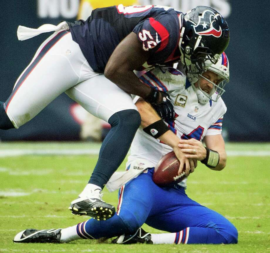 Texans linebacker Whitney Mercilus (59) sacks Bills quarterback Ryan Fitzpatrick (14) during the fourth quarter. Photo: Smiley N. Pool, Houston Chronicle / © 2012  Houston Chronicle