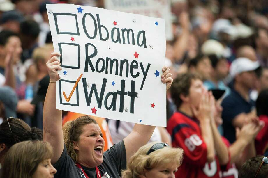 A fan shows her support for Texans defensive end J.J. Watt with an election themed sign during the first half. Photo: Smiley N. Pool, Houston Chronicle / © 2012  Houston Chronicle