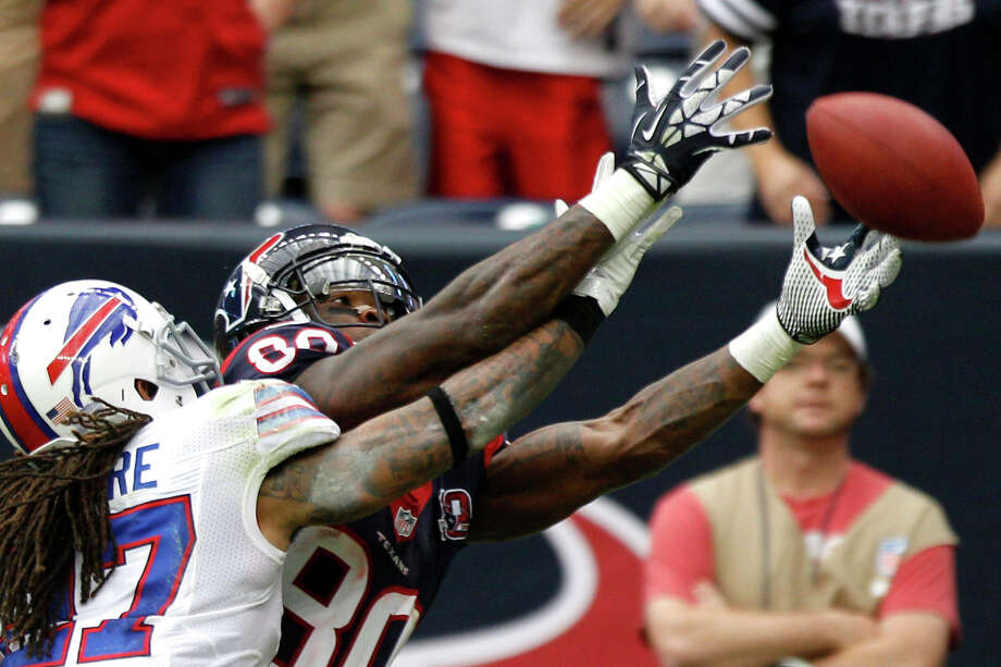 Texans wide receiver Andre Johnson (80) and Bills cornerback Stephon Gilmore (27) reach for a pass in the end zone during the fourth quarter. Photo: Brett Coomer, Houston Chronicle / © 2012  Houston Chronicle