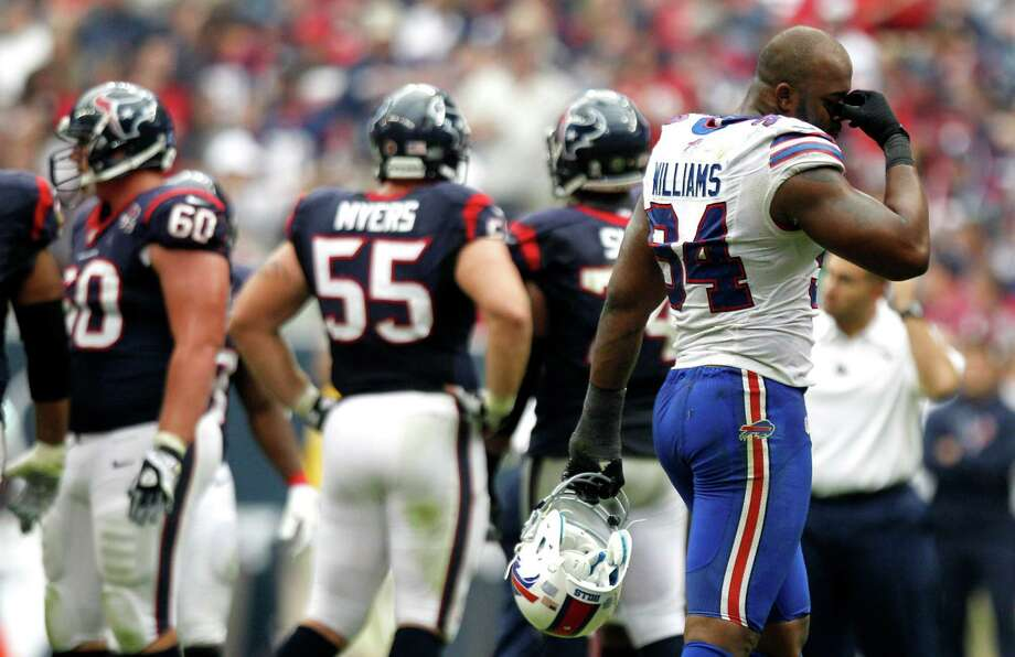 Bills defensive end Mario Williams (94) walks back to the huddle during a timeout in the fourth quarter. Photo: Brett Coomer, Houston Chronicle / © 2012  Houston Chronicle