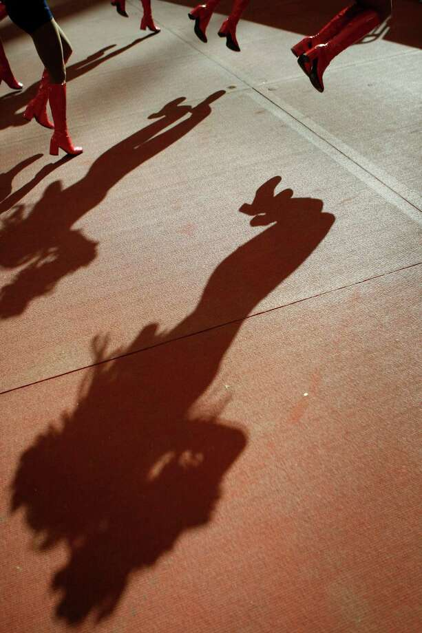 The shadows of Texans cheerleaders are cast on the sidelines as they perform during the fourth quarter. Photo: Nick De La Torre, Houston Chronicle / © 2012  Houston Chronicle