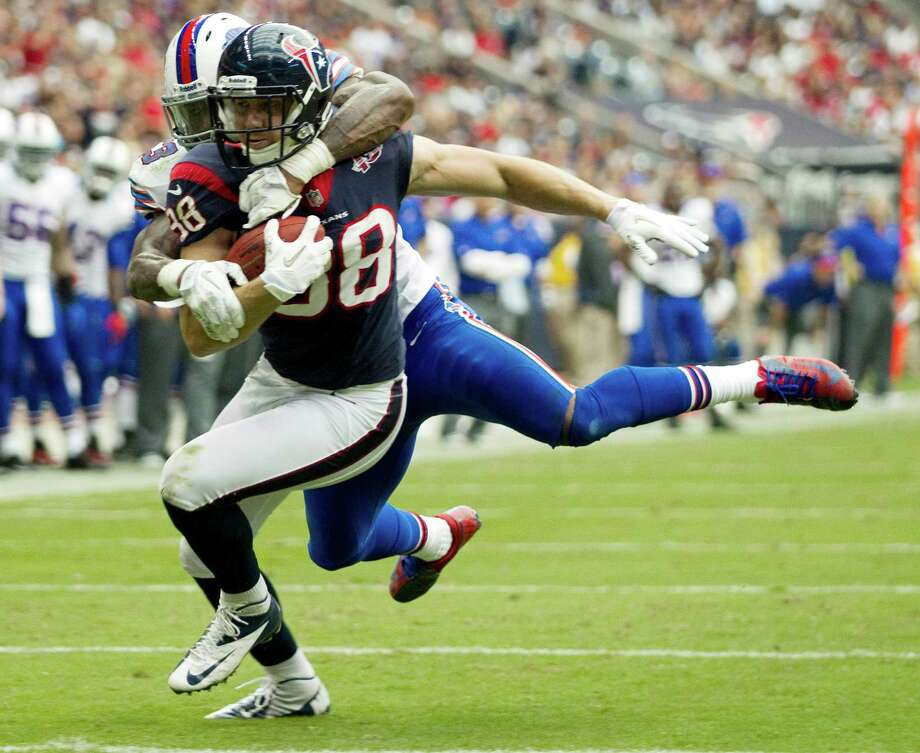 Texans tight end Garrett Graham (88) is hit by Bills outside linebacker Nigel Bradham (53) on a catch near the goal line during the fourth quarter. Photo: Brett Coomer, Houston Chronicle / © 2012  Houston Chronicle