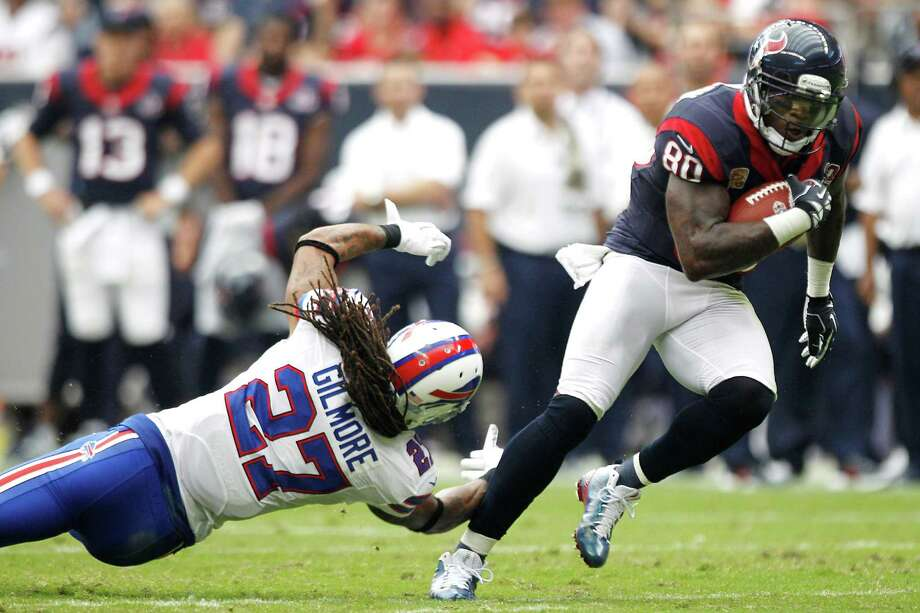 Texans wide receiver Andre Johnson (80) breaks away from Bills cornerback Stephon Gilmore (27) after catching a Matt Schaub pass during the fourth. Photo: Brett Coomer, Houston Chronicle / © 2012  Houston Chronicle
