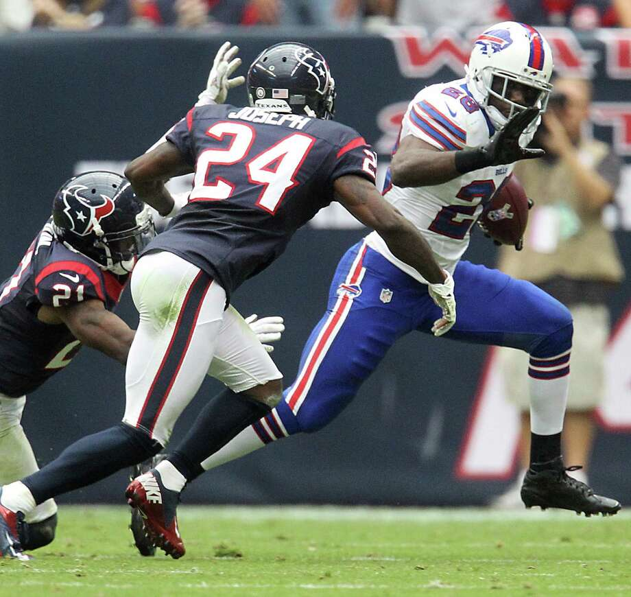 Bills running back C.J. Spiller (28) tries to avoid Houston Texans defensive backs Bryce McCain (21) and Johnathan Joseph (24) during the third quarter. Photo: Karen Warren, Houston Chronicle / © 2012  Houston Chronicle