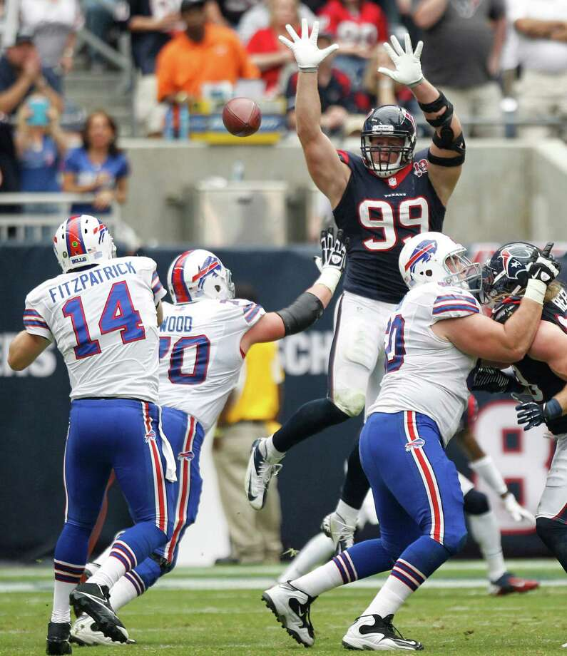 Texans defensive end J.J. Watt (99) leaps up to defend a pass by Bills quarterback Ryan Fitzpatrick (14) during the second quarter. Photo: Brett Coomer, Houston Chronicle / © 2012  Houston Chronicle