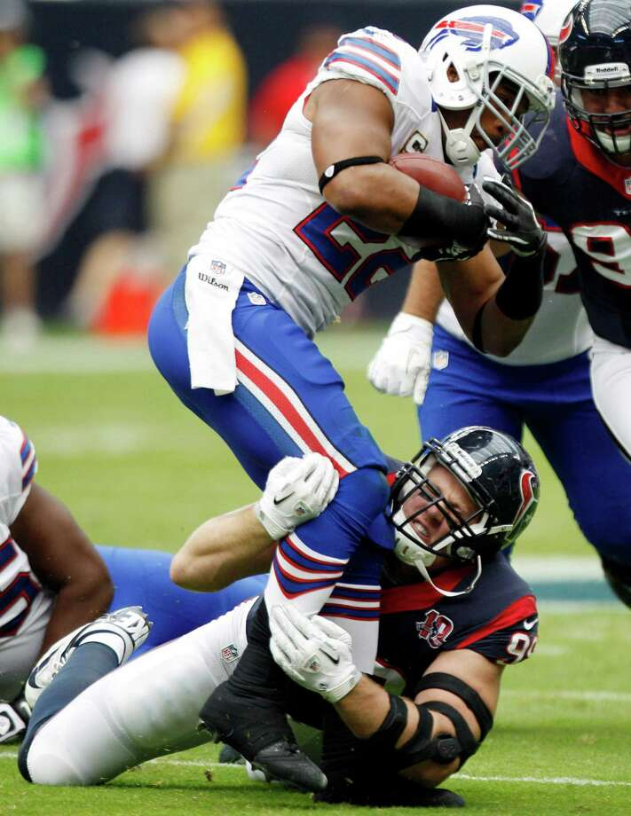 Texans defensive end J.J. Watt (99) makes a tackle on Bills running back Fred Jackson (22) during the first quarter. Photo: Brett Coomer, Houston Chronicle / © 2012  Houston Chronicle