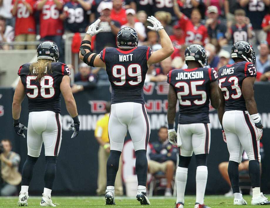 Texans defensive end J.J. Watt (99) tries to fire up the crowd during the first quarter. Photo: Karen Warren, Houston Chronicle / © 2012  Houston Chronicle