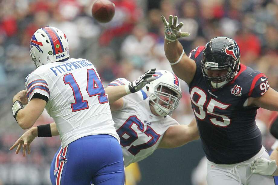 Bills quarterback Ryan Fitzpatrick (14) throws a pass against the defense of Houston Texans nose tackle Shaun Cody (95) during the second quarter. Photo: Karen Warren, Houston Chronicle / © 2012  Houston Chronicle