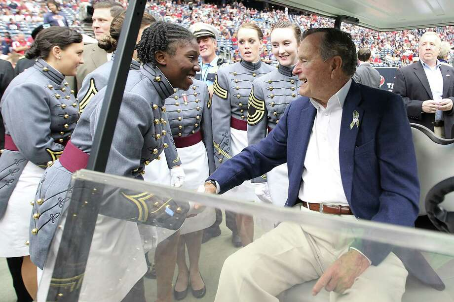 Former President George H.W. Bush greets members of the West Point glee club on the sidelines before the game. Photo: Karen Warren, Houston Chronicle / © 2012  Houston Chronicle
