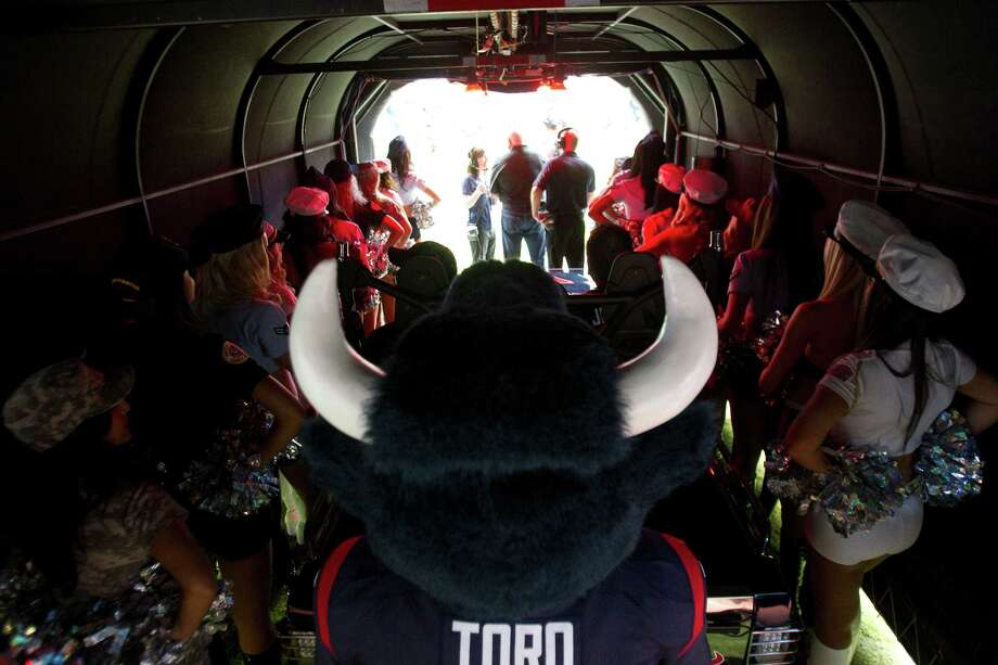 Houston Texans mascot Toro waits in the tunnel to take the field before facing the Texans faced the Bills at Reliant Stadium. Photo: Brett Coomer, Houston Chronicle / © 2012  Houston Chronicle