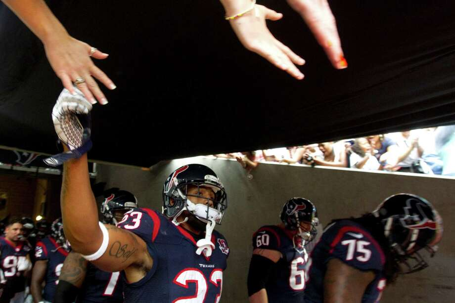 Texans running back Arian Foster high-fives fans before taking the field to  face the Buffalo Bills. Photo: Brett Coomer, Houston Chronicle / © 2012  Houston Chronicle