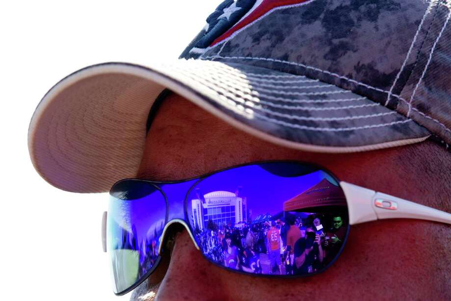 Reliant Stadium is reflected in a pair of sunglasses before the Houston Texans game against the Buffalo Bills. Photo: Brett Coomer, Houston Chronicle / © 2012  Houston Chronicle