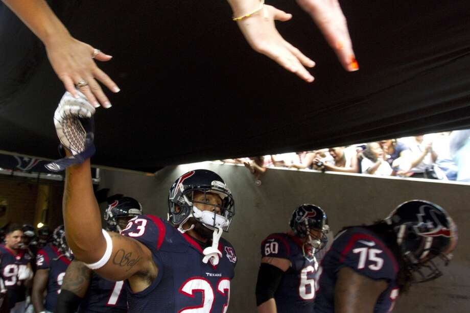 Texans running back Arian Foster high-fives fans before taking the field to  face the Buffalo Bills. (Brett Coomer / Houston Chronicle)