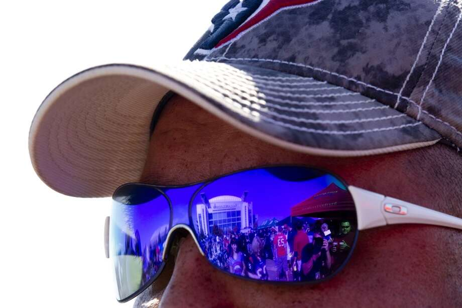 Reliant Stadium is reflected in a pair of sunglasses before the Houston Texans game against the Buffalo Bills. (Brett Coomer / Houston Chronicle)
