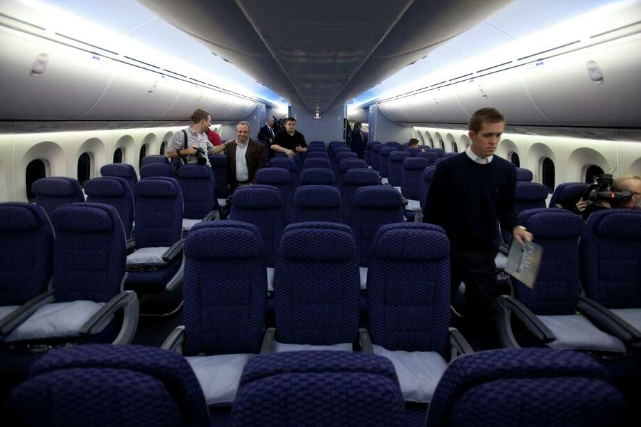 Members of the media check out the amenities of the Dreamliner's cabin before the jet began a busy day: Houston to Chicago, back to Houston, then on to L.A. Photo: Eric Kayne, MBI / Houston Chronicle