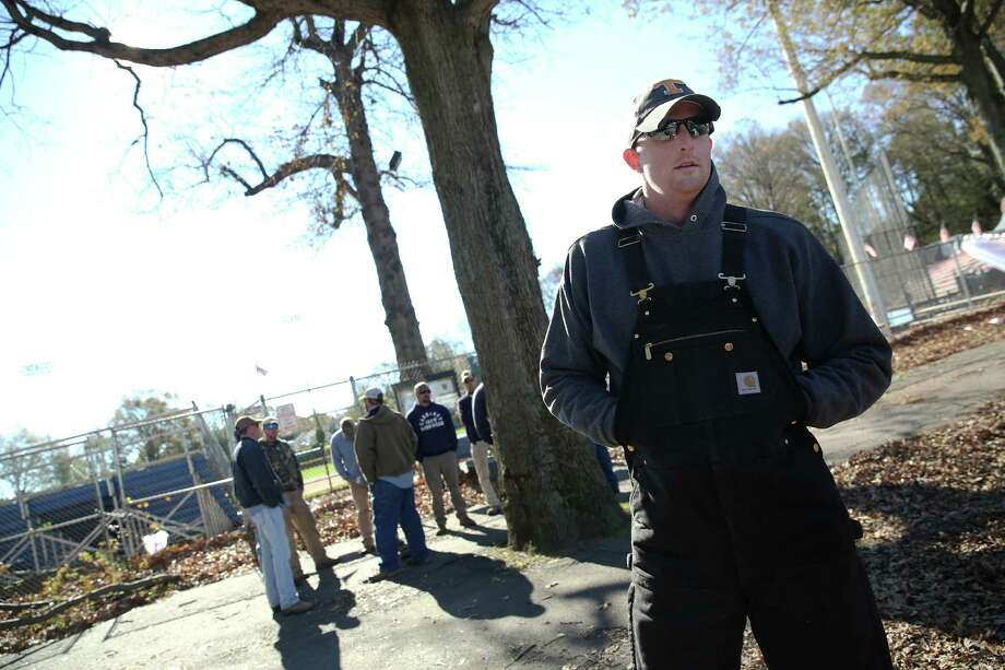 Mike Ross Connecticut Post freelance - Service Electric Company lineman Baxter Lowe of Tennessee waits at staging area at Scalzi Park in Stamford on Sunday. Lowe and about 275 contractors are in area helping local authorities with restoring power for residents in state. Photo: Mike Ross / Connecticut Post Freelance