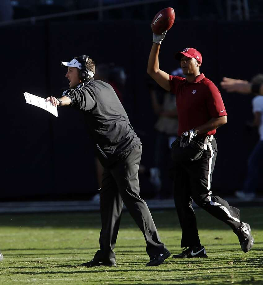Raiders head coach Dennis Allen tries to yell out some signals from the side lines. The Oakland Raiders played the Tampa Bay Buccaneers at O.co Coliseum in Oakland, Calif., on Sunday, November 4, 2012, losing 42-32 to the Bucs. Photo: Carlos Avila Gonzalez, The Chronicle