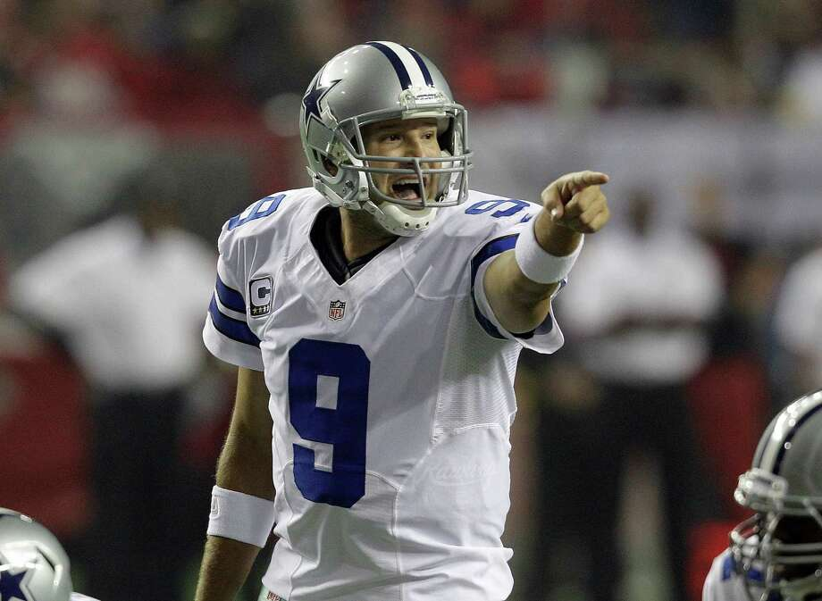 Dallas Cowboys quarterback Tony Romo (9) calls a play during the first half of an NFL football game against the Atlanta Falcons  Sunday, Nov. 4, 2012, in Atlanta. (AP Photo/Chuck Burton) Photo: Chuck Burton, Associated Press / AP