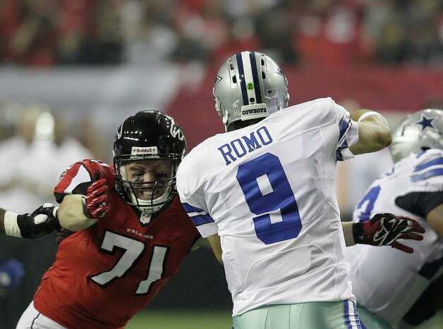 Dallas Cowboys quarterback Tony Romo (9) is hit Atlanta Falcons defensive end Kroy Biermann (71) as he throws a pass during the first half of an NFL football game Sunday, Nov. 4, 2012, in Atlanta. (AP Photo/Chuck Burton) Photo: Chuck Burton, Associated Press / AP