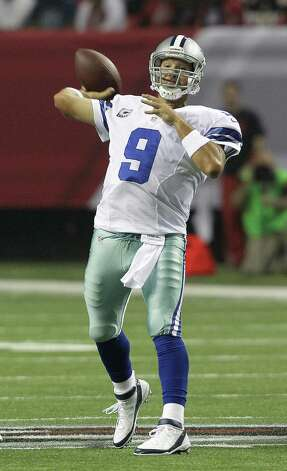Dallas Cowboys quarterback Tony Romo (9) throws a pass during the first half of an NFL football game against the Atlanta Falcons Sunday, Nov. 4, 2012, in Atlanta. (AP Photo/Chuck Burton) Photo: Chuck Burton, Associated Press / AP