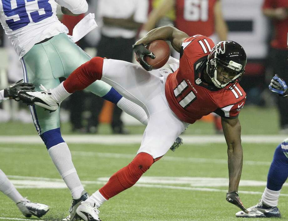 Atlanta Falcons wide receiver Julio Jones (11) is shown during the first half of an NFL football game against the Dallas Cowboys  Sunday, Nov. 4, 2012, in Atlanta. (AP Photo/Chuck Burton) Photo: Chuck Burton, Associated Press / AP
