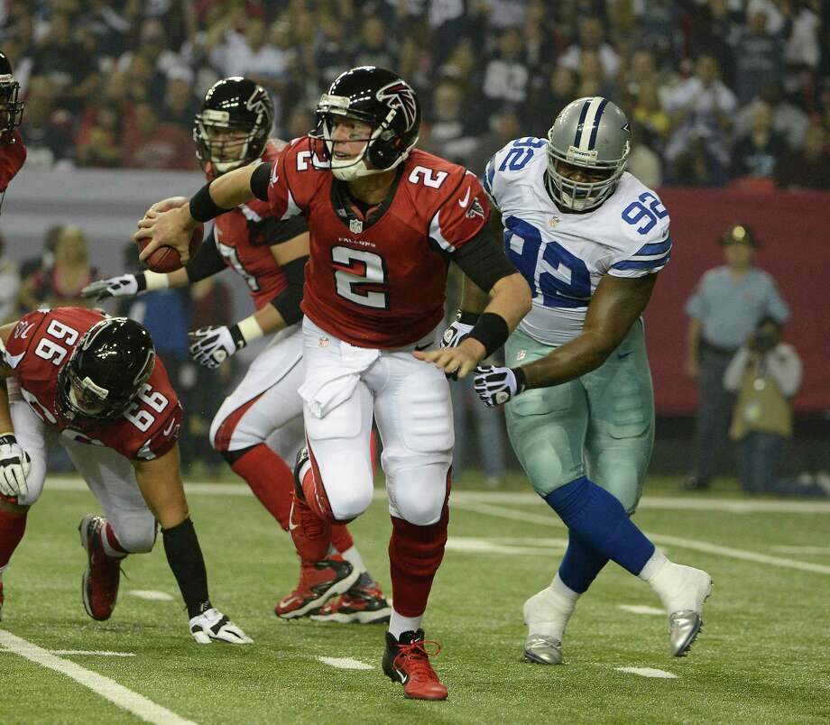 Atlanta Falcons quarterback Matt Ryan (2) scrambles as Dallas Cowboys nose tackle Josh Brent (92) gives chase during the first half of an NFL football game Sunday, Nov. 4, 2012, in Atlanta. (AP Photo/Rich Addicks) Photo: Rich Addicks, Associated Press / FR170246 AP
