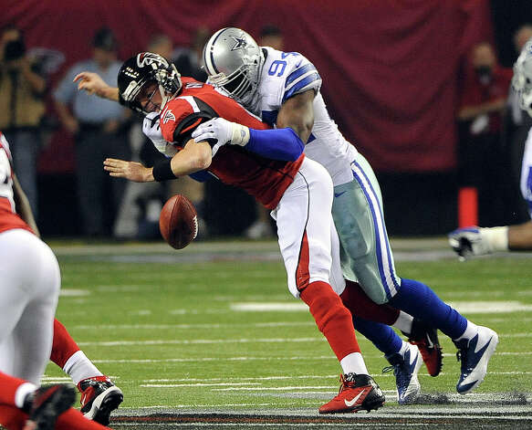 Atlanta Falcons quarterback Matt Ryan (2) looses the football as he is sacked by Dallas Cowboys linebacker DeMarcus Ware (94) during the first half of an NFL football game, Sunday, Nov. 4, 2012, in Atlanta. Atlanta recovered the fumble. (AP Photo/David Tulis) Photo: David Tulis, Associated Press / FR170493 AP
