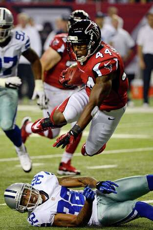 Atlanta Falcons fullback Jason Snelling (44) is stopped by Dallas Cowboys cornerback Orlando Scandrick (32) during the first half of an NFL football game, Sunday, Nov. 4, 2012, in Atlanta. (AP Photo/Rich Addicks) Photo: Rich Addicks, Associated Press / FR170246 AP