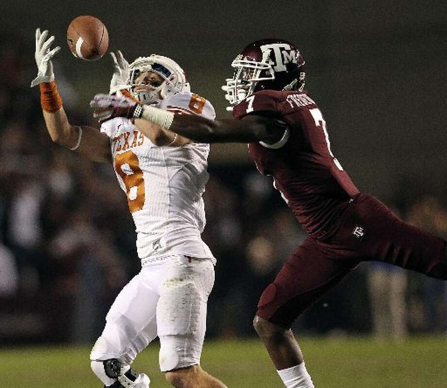 Jaxon Shipley catches a pass in front of Terrence Frederick in the first quarter as Texas A&M hosts UT at Kyle Field in College Station on November 24, 2011. Tom Reel/Express-News