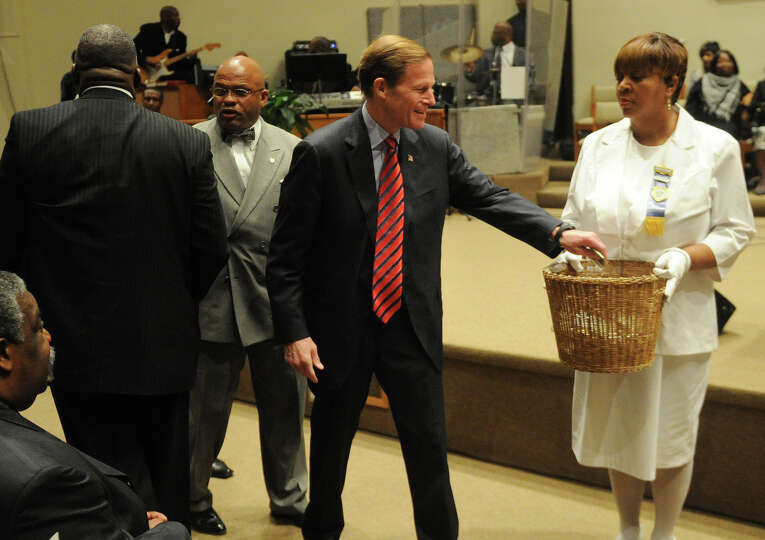 Senator Richard Blumenthal makes a donation during a get out the vote rally at Mt. Aery Baptist Chur