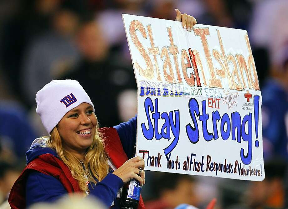 A fan supports storm-battered Staten Island and thanks relief responders. Photo: Rich Schultz, Getty Images