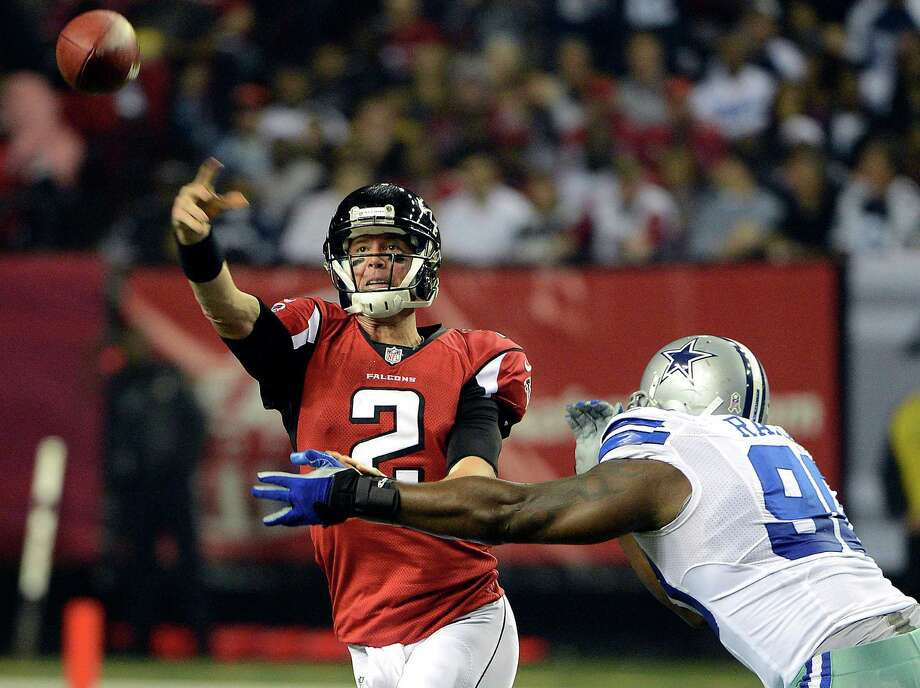 Atlanta Falcons quarterback Matt Ryan (2) throws under pressure from Dallas Cowboys nose tackle Jay Ratliff (90) during the first half of an NFL football game, Sunday, Nov. 4, 2012, in Atlanta. (AP Photo/Rich Addicks) Photo: Rich Addicks, Associated Press / FR170246 AP